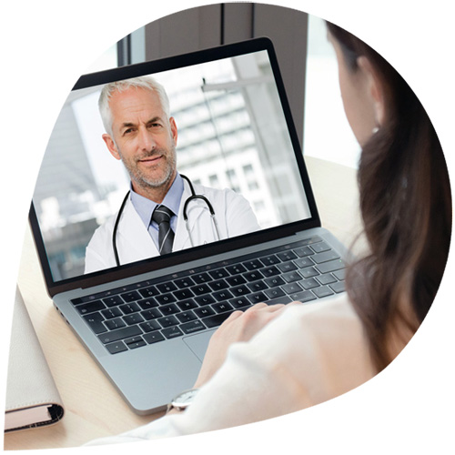 A woman video chatting with a doctor
